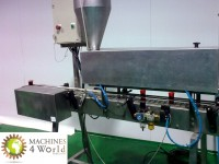 AL0040911-Filling and dosing machine for dense products.