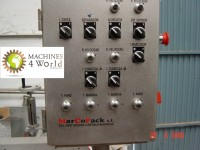 AL0330911- Marcopack Labeling machine with two head for small bottles.